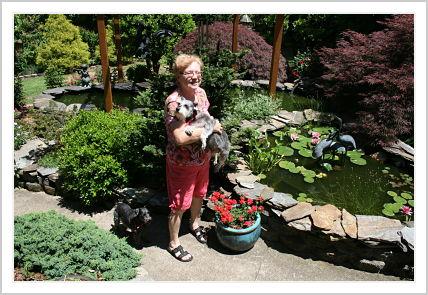 My frugal German mother standing in front of her water-garden